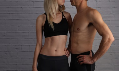 Two fit people standing next to each other